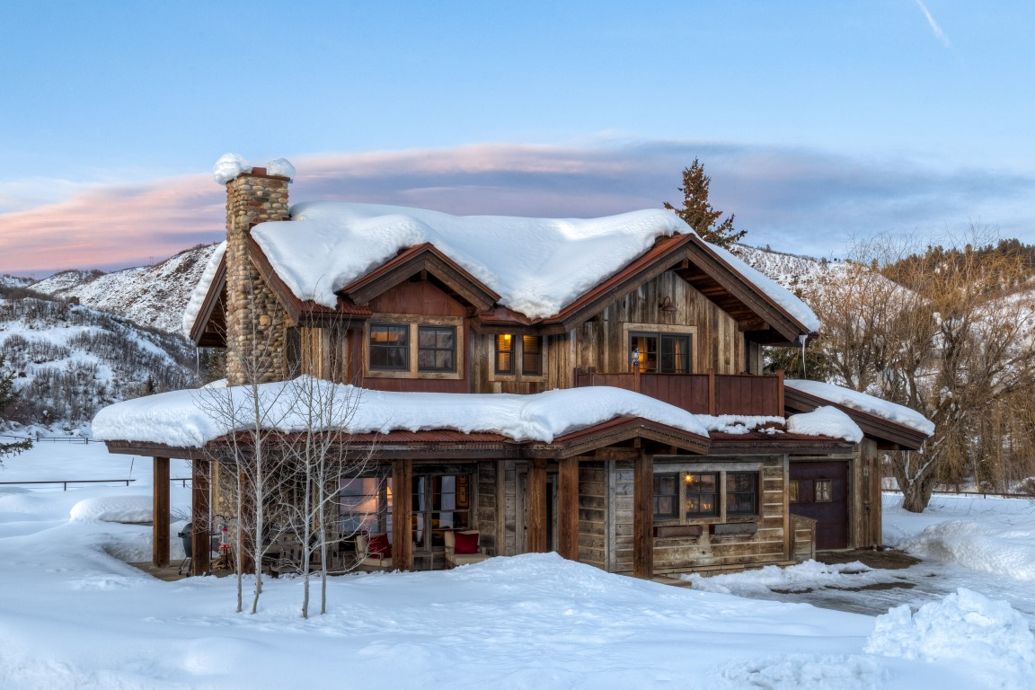 Steamboat River Ranch main house covered in snow