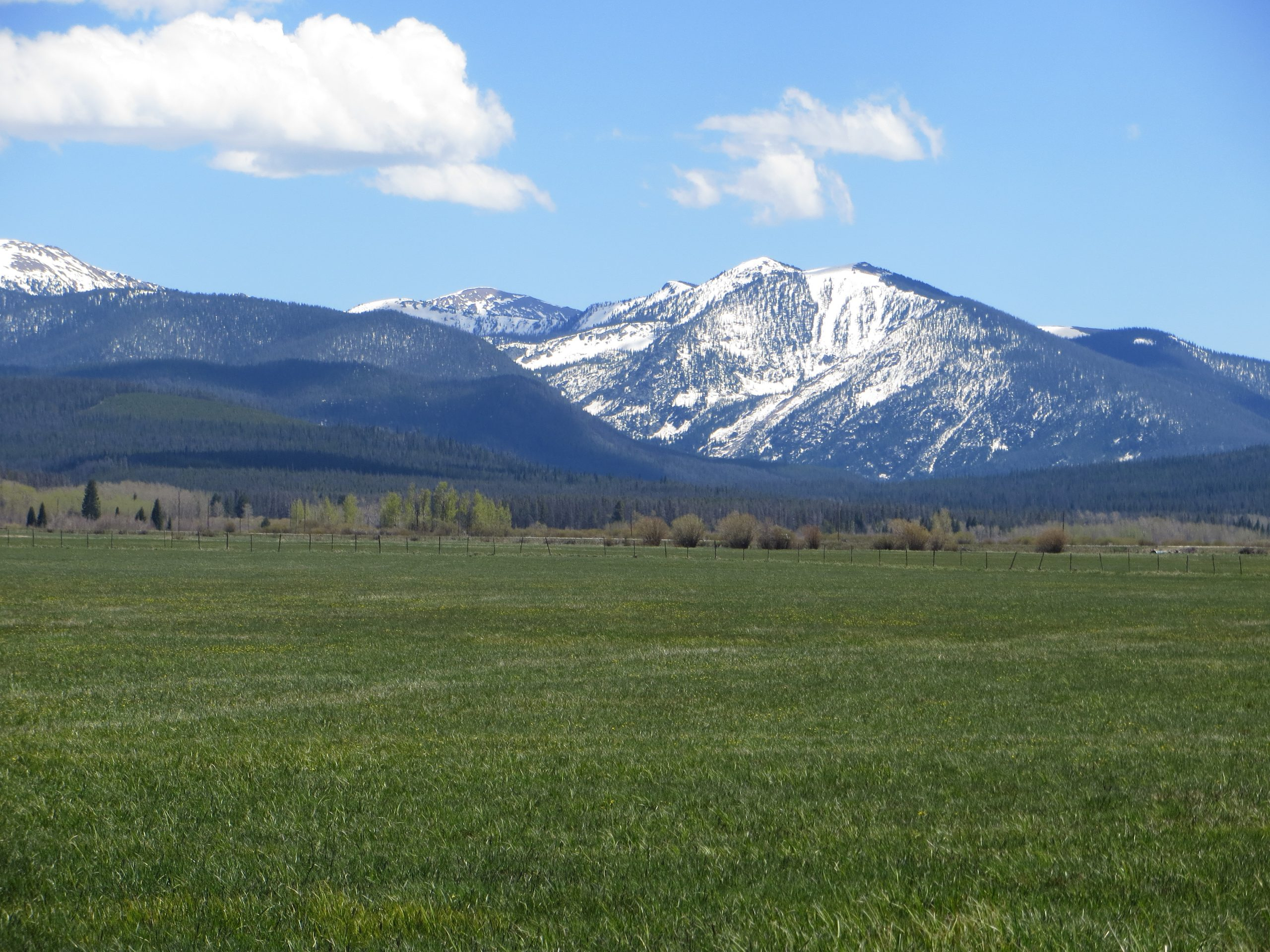 Colorado snow capped peaks scream adventure
